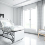 White hospital room with bed